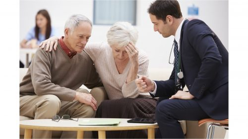 Couple learning about prostate cancer and erectile dysfunction from a doctor